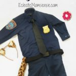 Officer Clawhauser costume with pink sprinkle donut.